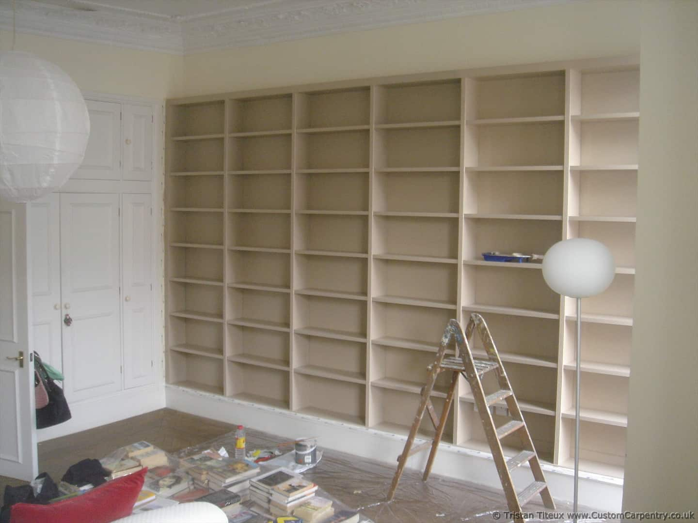 Bookcase Is Built In Line With The Top Of Other Cupboard Which Makes It Look More Like At Same Time