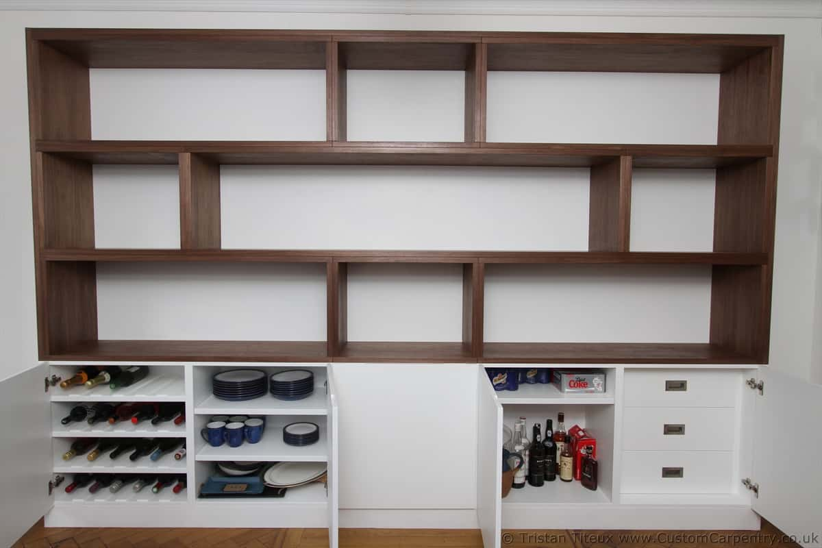 Bespoke shelves made from walnut veneer on a white background with doors below