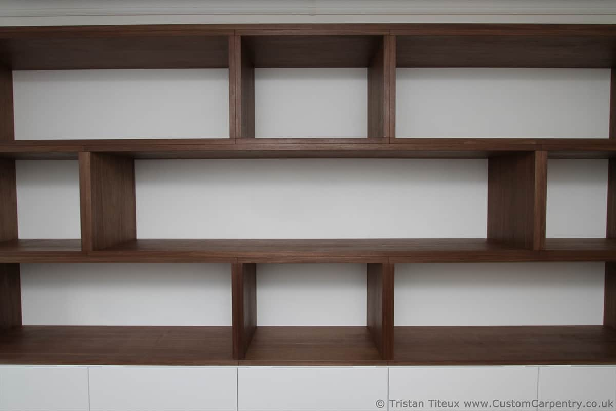 Bespoke shelves made from oiled walnut veneer with a white painted back